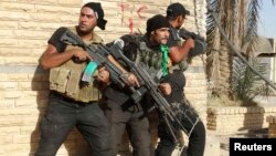 Members of Iraqi security forces conduct a patrol looking for Islamic State (IS) militants in Ramadi earlier this year. IS has made a concerted push to take the city in recent weeks.