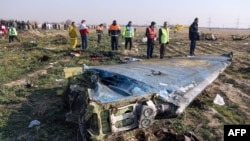 Emergency crews survey the scene of a Ukrainian jetliner shot down by an Iranian missile near Tehran.