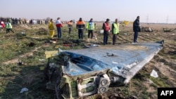 Rescue teams at the site where a Ukrainian airliner crashed in January after being shot down by Iranian defense forces. All 176 people on board the plane died in the incident.