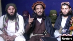 A video grab shows Omar Khalid Khorasani (C), the purported leader of Jamaat-ul-Ahrar (file photo).
