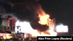Smoke is seen rising from flames engulfing the stage after a fire broke out at Tomorrowland Unite Spain festival in Barcelona, Spain July 29, 2017, in this still image from a video obtained from social media. Alex Prim Lopez via REUTERS ATTENTION EDITOR