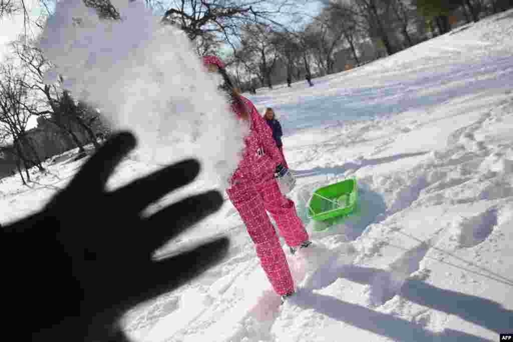 "Children throw snowballs in New York's Central Park on January 3, after a winter storm called ""Hercules"" struck the Northeast."