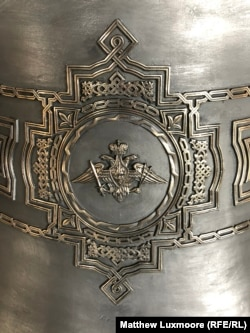 The emblem of the Russian armed forces' Strategic Missile Troops on a bell at the Anisimov bell foundry destined for the Armed Forces Cathedral