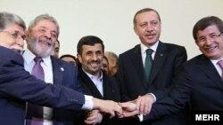 Brazilian Foreign Minister Celso Amorim (left), Brazilian President Luiz Inacio Lula da Silva, Iranian President Mahmud Ahmadinejad, Turkish Prime Minister Recep Tayyip Erdogan, and Turkish Foreign Minister Ahmet Davutoglu pose in Tehran today.