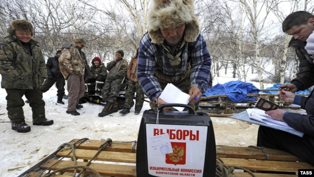 A local man casts his ballot in a portable ballot box during a vote in hard-to-reach areas of Kamchatka on February 20.