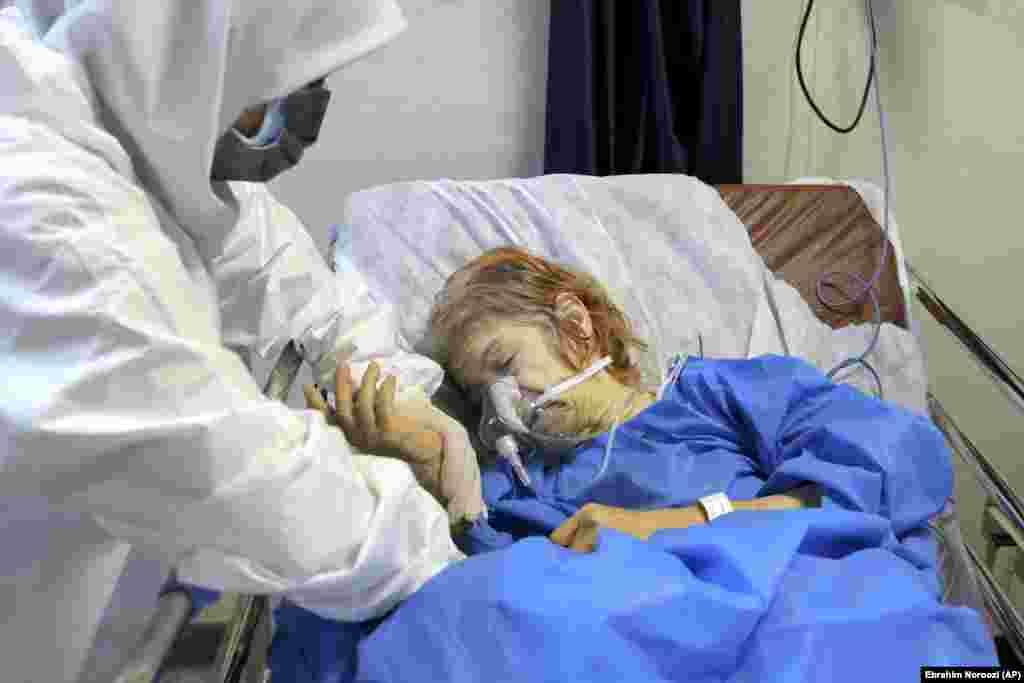 A nurse tends to a patient at Shohadaye Tajrish Hospital in the capital, Tehran.