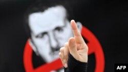 Плякат супраць дзейнага кіраўніка Сірыі Башара Асада.