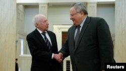 Greek Foreign Minister Nikos Kotzias (right) welcomes UN envoy Matthew Nimetz in Athens on January 30.