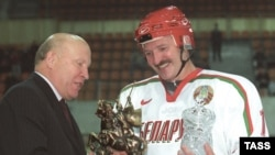 Lukashenka receives a trophy after a more successful match.