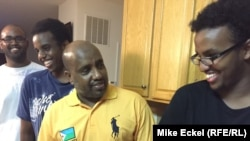Faisal Abdi (center) stands in his kitchen along with his sons Kayse, Guleid, and Samakb after watching the third, and final, presidential debate between Republican Donald Trump and Democrat Hillary Clinton at his home in Woodbridge, Virginia, on October 19.