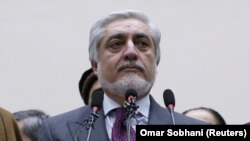 "Losing presidential candidate Abdullah Abdullah slammed the result as a ""coup"" and vowed to form ""an all-inclusive government."""