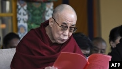 The Dalai Lama reads a statement from the Tibetan parliament-in-exile during a ceremony marking the 52nd anniversary of the 1959 Tibetan uprising in Dharamshala today.