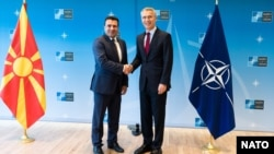Macedonian Prime Minister Zoran Zaev (left) shakes hands with NATO Secretary-General Jens Stoltenberg in Brussels in June.
