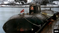 An undated photo of the ill-fated Kursk submarine at her mooring at a base of Vidyayevo, Russia.