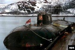 An undated photo of the ill-fated Kursk submarine at her mooring at a base in Vidyayevo, Russia.