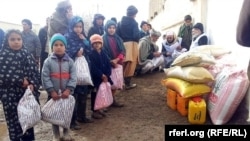 Winter aid is distributed to needy families in Herat Province on January 9.