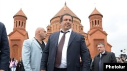 Armenia - Businessman Gagik Tsarukian is seen against the backdrop of the newly built Surp Hovannes church built by him in Abovian, 14May2013.