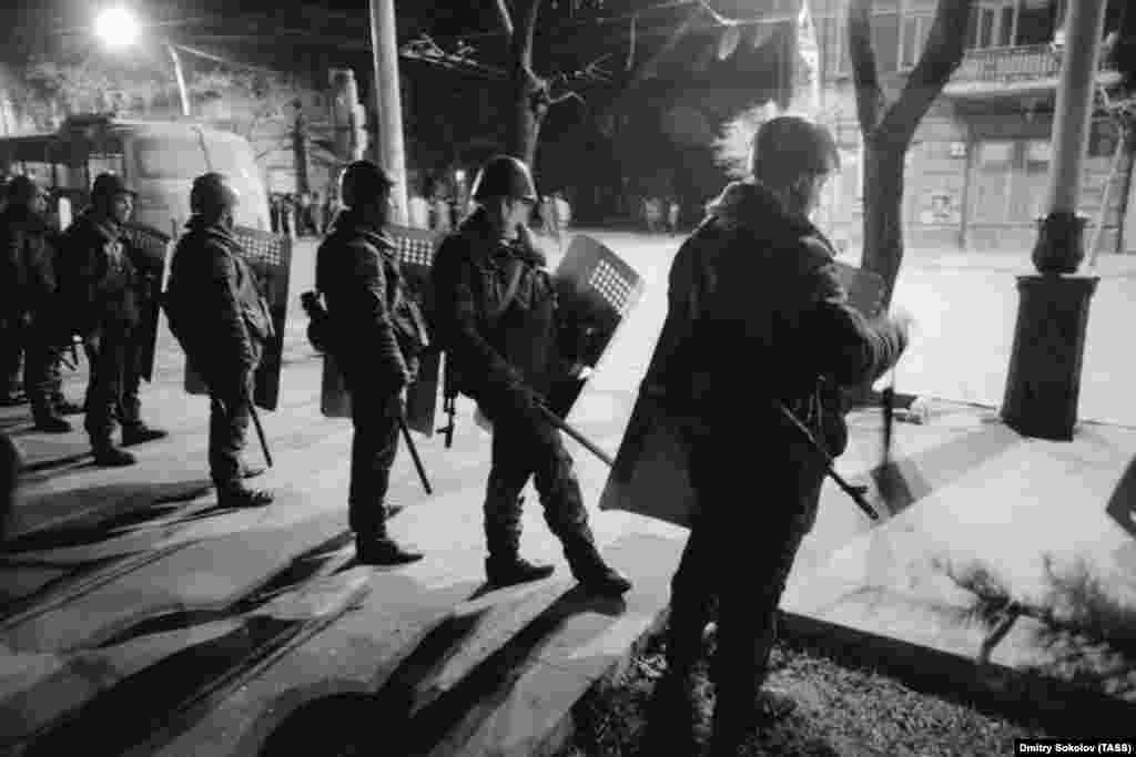 Soviet soldiers block a Baku street on the night of January 19, 1990. Moscow declared a state of emergency and moved in troops after ethnic violence flared between Armenians and Azerbaijanis. Soviet officials used the tensions as a pretext to suppress a growing nationalist movement and support for the pro-independence Popular Front of Azerbaijan.