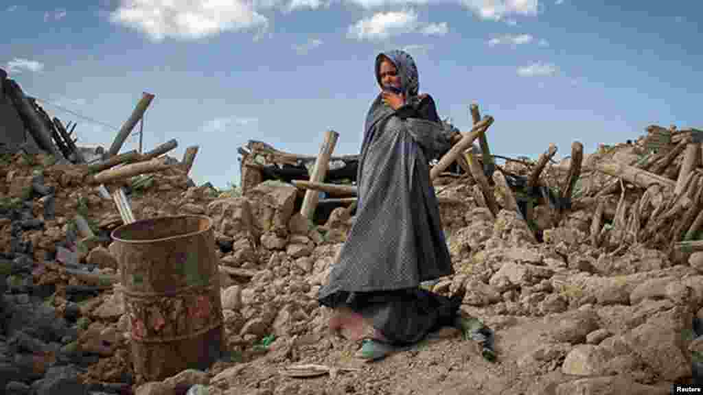 An earthquake victim stands near damaged houses in the earthquake-stricken town of Azerbaijan, Iran. (Reuters/Farshid Tighehsaz/ISNA)