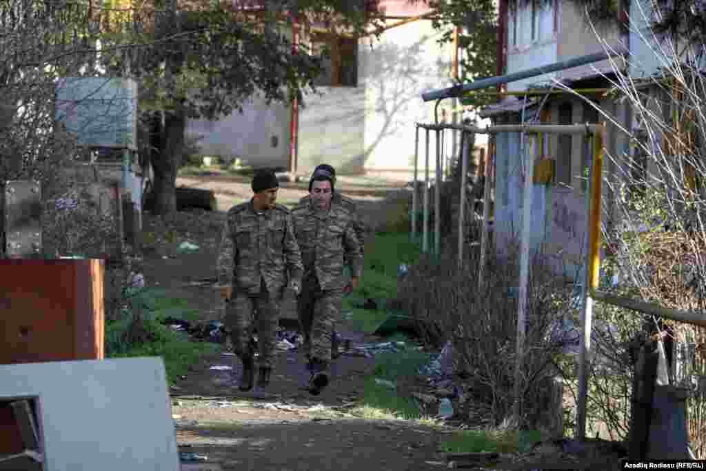 Azerbaijani troops pass a house in Hadrut on November 25.
