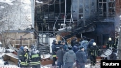 Police and rescue workers at the site of an explosion at Italian Il Pittore restaurant in Moscow on January 9 in which at least three people were killed.