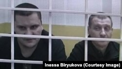 Filipp Romanov (left) and Sergei Bulanov in the courtroom during their trial last year