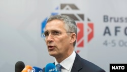 NATO Secretary-General Jens Stoltenberg speaking to journalists at a summit focusing on Afghanistan in Brussels on October 5.