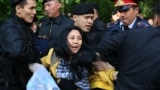 KAZAKHSTAN -- Kazakh police officers detain opposition protesters in Almaty, May 1, 2019