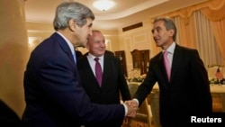 U.S. Secretary of State John Kerry (left) meets with Moldovan President Nicolae Timofti (center) and Prime Minister Iurie Leanca at the official residence in Chisinau on December 4.
