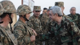 Nagorno-Karabakh - Armenian President Serzh Sarkisian shakes hands with soldiers on frontline duty, 22Oct2012.