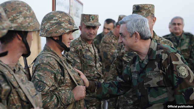 Armenian President Serzh Sarkisian meets with soldiers on frontline duty in Nagorno-Karabakh in October 2012.