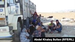 Persona të zhvendosur nga një qytet në Irak për shkak të luftimeve ndërmjet militantëve sunitë dhe forcave qeveritare
