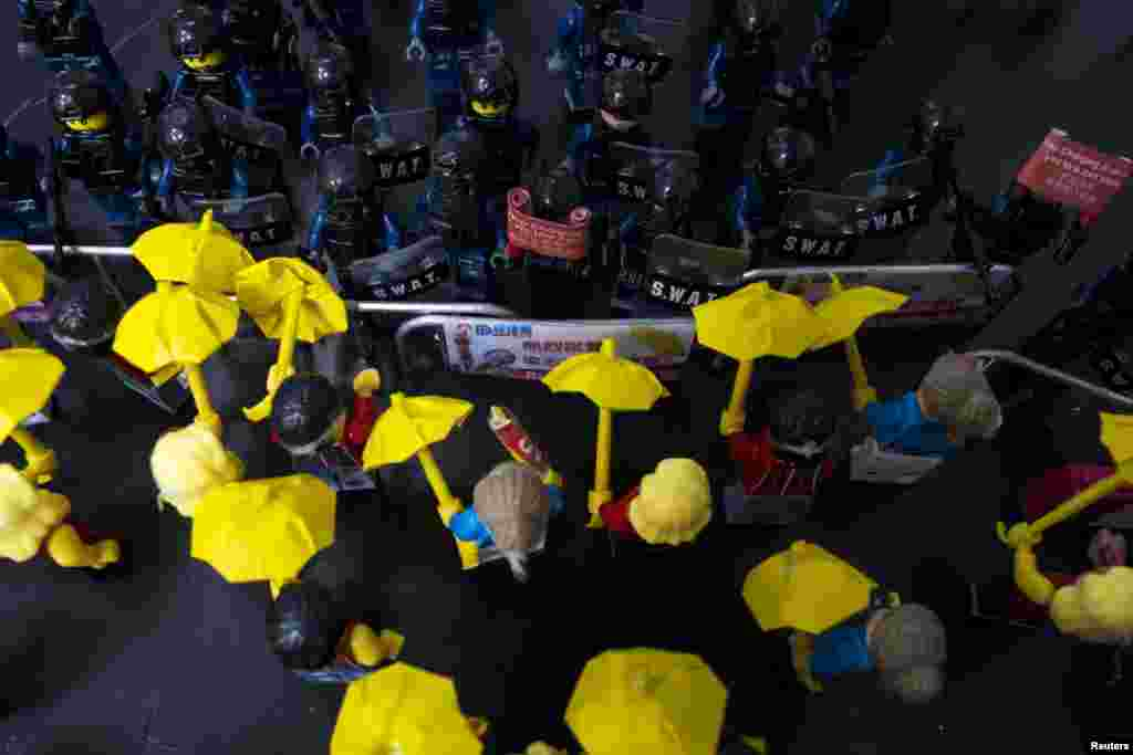 Toy Lego characters depicting a scene of protesters confronting riot police are seen on a table outside the government headquarters in Hong Kong. (Reuters/Tyrone Siu)