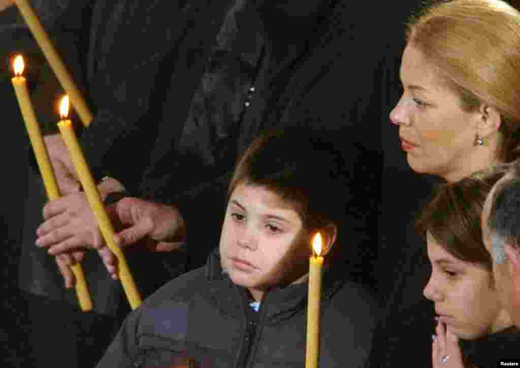 Djindjic's son Luka, wife, Ruzica, and daughter Jovana at the funeral service