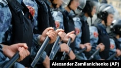 Police block a square during an unsanctioned rally in the center of Moscow on August 3.