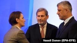 Serbian Prime Minister Ana Brnabic (left) speaks with Kosovar President Hashim Thaci (right) and EU Enlargement Commissioner Johannes Hahn, during a meeting in Sofia last month.