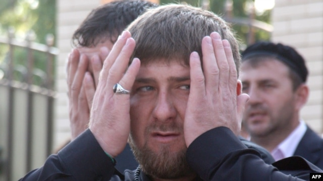 Ramzan Kadyrov prays as he visits a recently rebuilt district in Grozny on May 1.
