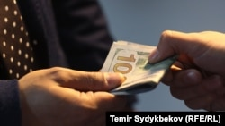 Kyrgyzstan - bribe, corruption, money, generic, undated