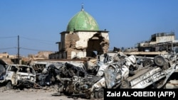 A picture taken in July shows the dome of the destroyed Al-Nuri Mosque in the Old City of Mosul, a year after the town was retaken by Iraqi government forces.