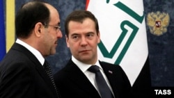 Russian Prime Minister Dmitry Medvedev and his Iraqi counterpart Nuri al-Maliki helds talks in Moscow on October 9.