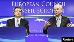 European Commission President Jose Manuel Barroso (left) and European Council President Herman Van Rompuy address a news conference at the end of an EU leaders summit in Brussels.