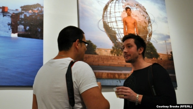 One of Kargaltsev's models, Dmitry (right), stands with another attendee on the exhibition's opening night.
