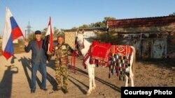 Ullubii (left) with Azzan and Star of Putin in Daghestan