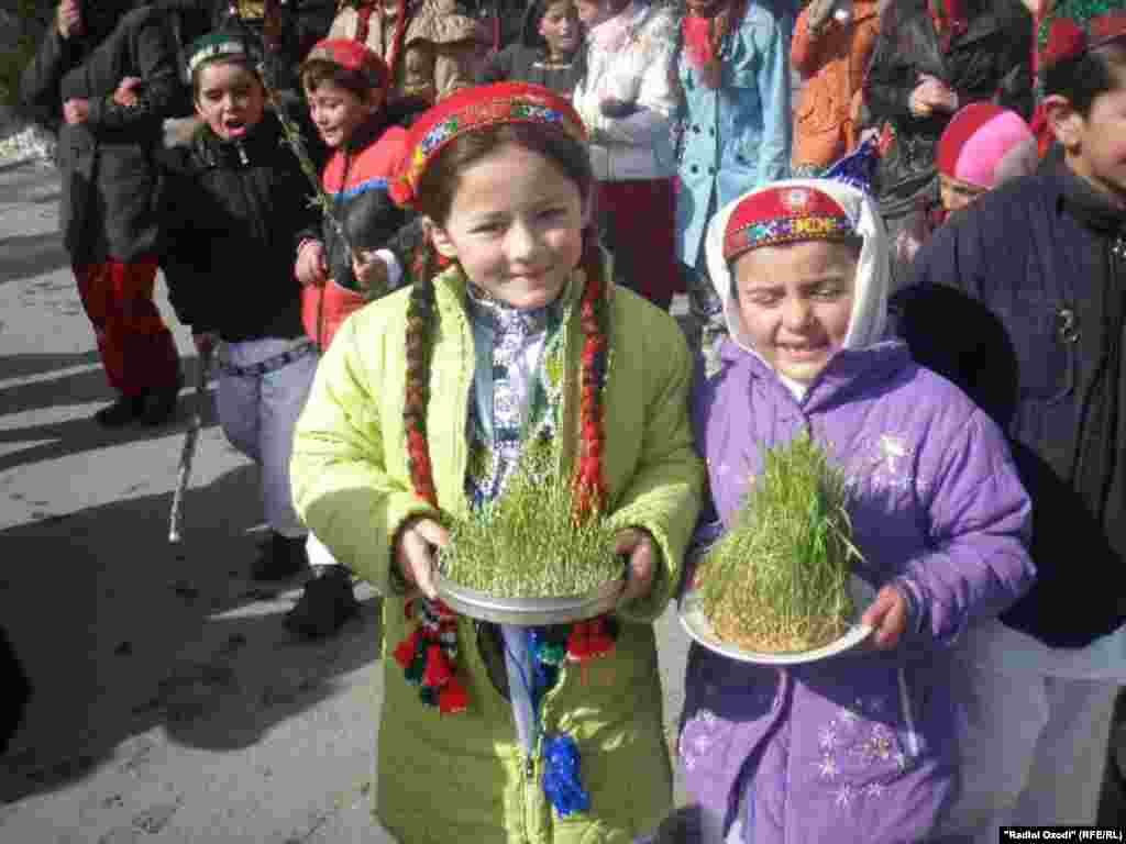 Girls in the city of Khorugh show off their wheat sprouts.