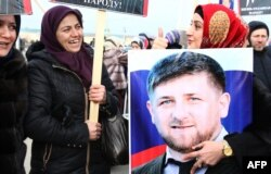A Chechen woman holds a picture of Ramzan Kadyrov during a rally in central Grozny last month.