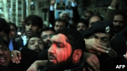 Arrested Pakistani bodyguard Malik Mumtaz Hussain Qadri leaves the court in Islamabad on January 5