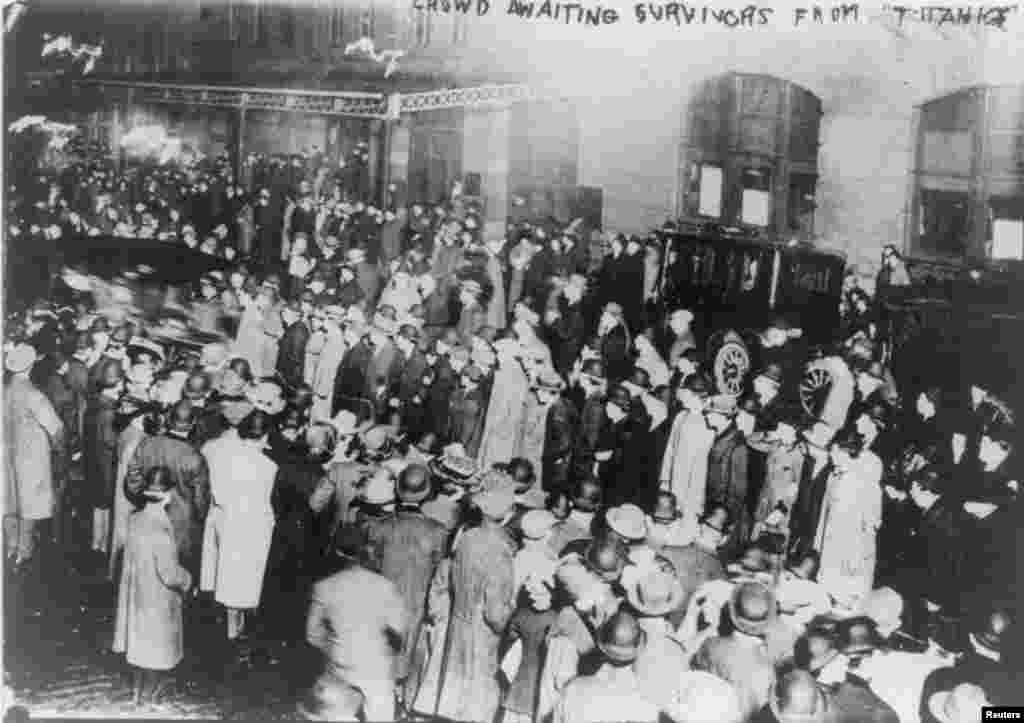 "A crowd in New York awaits survivors from the ""Titanic"" to arrive aboard the ""Carpathia"" on April 18, 1912."