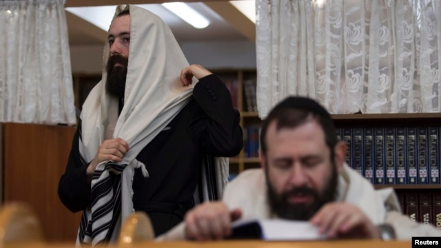 Jewish men attend morning prayers at a synagogue in Donetsk, in eastern Ukraine.