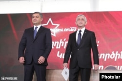 Artur Vanetsian (left) appears with ex-President Serzh Sarkisian at a party rally earlier this month.