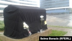 A memorial to months-old Belmina Ibrisevic, who died in a German clinic after delays in getting a passport.